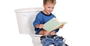 Boy Reading While Potty Training